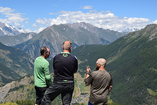 Alpine Revolution Staff looking over mountains